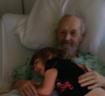 Ron in the hospital with his great-granddaughter, Sammy